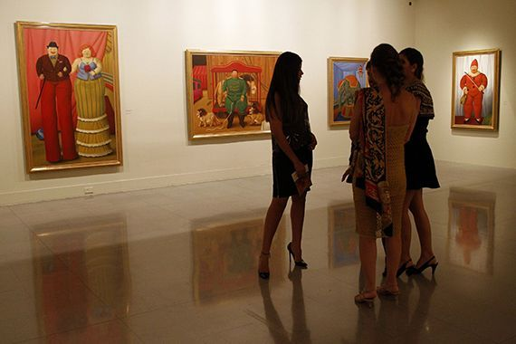 "People attend the opening of Colombian painter and sculptor Fernando Botero's exhibition ""The Circus"" at the Museum of Antioquia in Medellin"